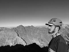 Matt Odierna on the summit of Pyramid Peak looking towards the Maroon Bells