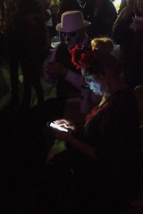 Checking Her Phone In The Darkness Of The Night