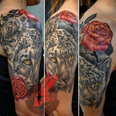 Snow Leopard Black and Grey Golden Eyes Fire Roses Orange Yellow Best Real Realistic 3D Tattoo by Jackie Rabbit