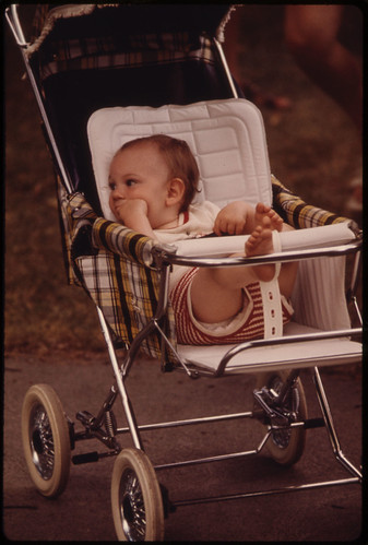 Youngster in a Stroller Awaits His Family in New Ulm Minnesota...