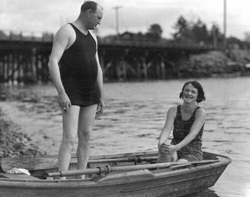 Man and woman in bathing suits in a rowboat near Tacoma, Washington