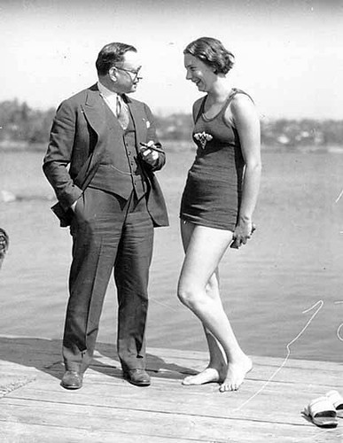 Helene Madison in a bathing suit with Seattle Park Board President Simon Burnett, Seattle, Washington