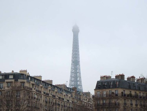 Eiffel Tower rising into the fog