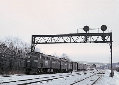 PC E8A 4275 with Train 25, The Duquesne, passing Port Tower, Newport, PA on January 11, 19780