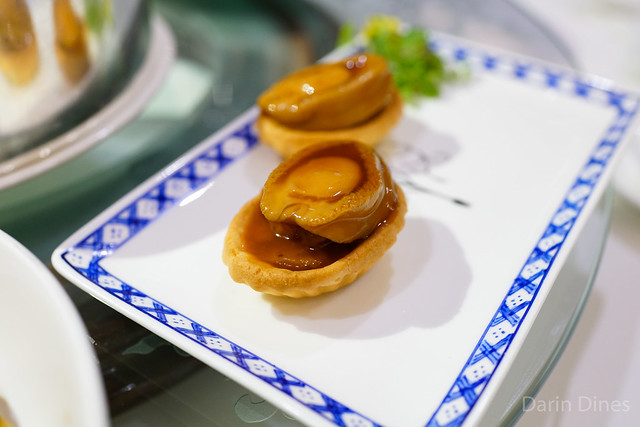 Baked pastries filled with whole abalone and fish maw