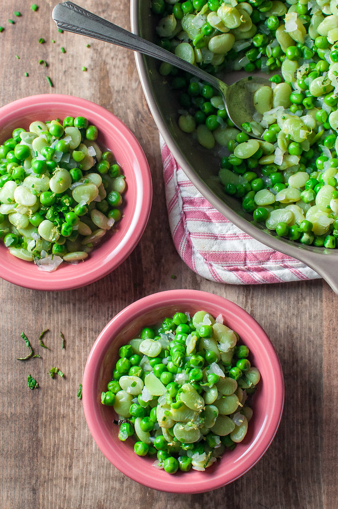 Quick buttered peas all gussied up for springtime celebrations, with pretty (protein-packed) lima beans, bright citrus, and sweet onion.
