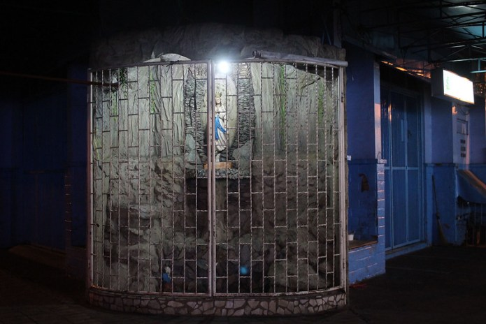 virgin mary grotto behind grilles- makati - at night 2