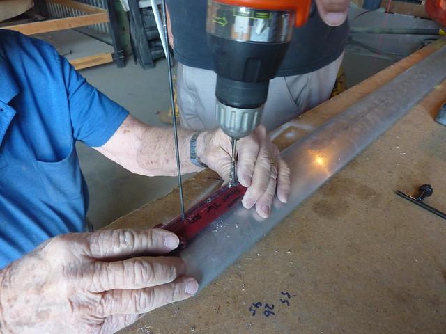 Strut hole drilling technique