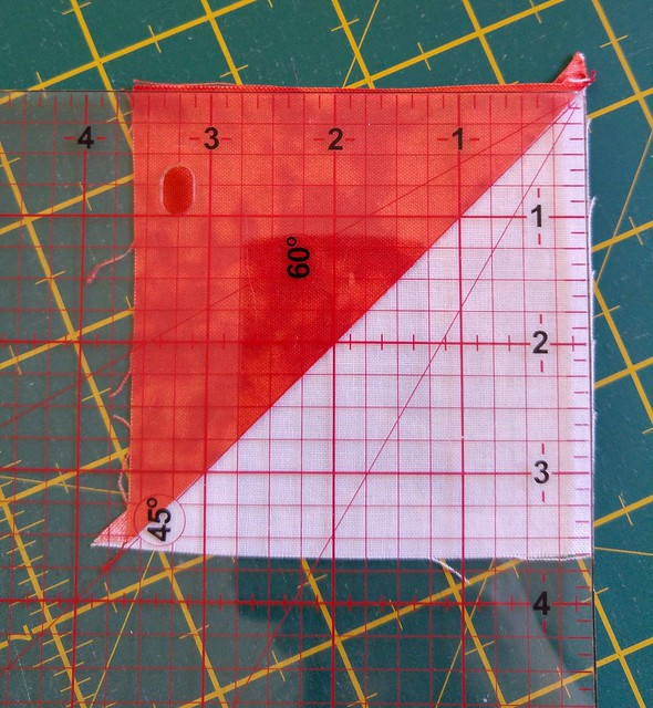 First cuts trimming the half square triangle to size
