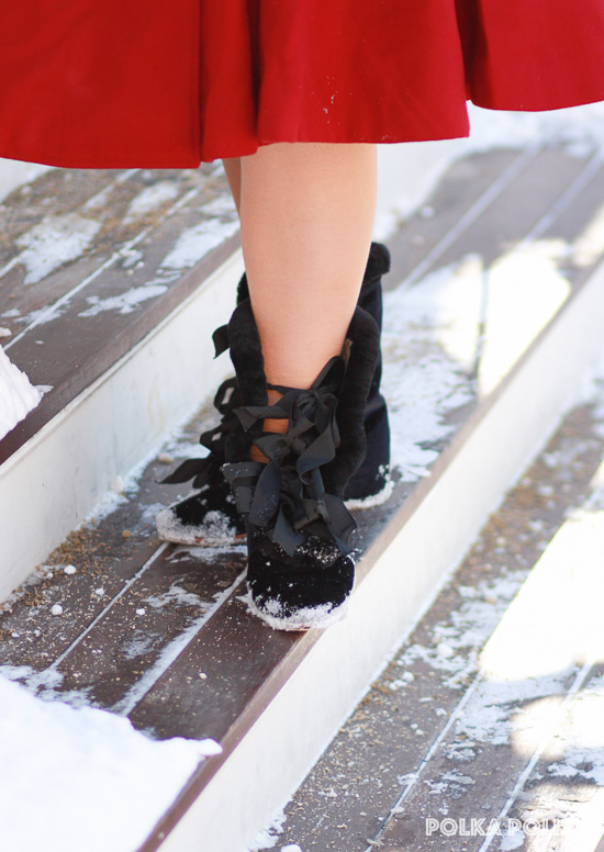 American Duchess Victoria carriage boots from Royal Vintage Shoes, styled for the 1950s on a snowy step