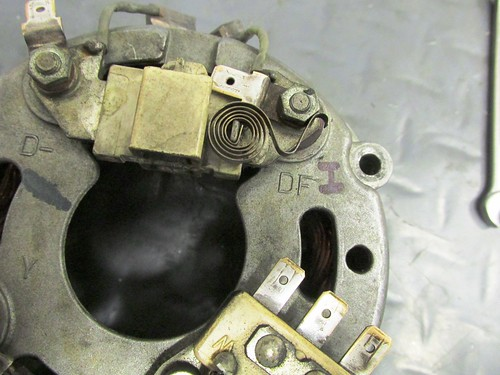 Clean Alternator 3-Phase Terminals, Coil Spring Removed and Loosening Brush Terminal