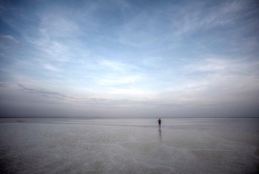 Heather walking in Lake Karum.