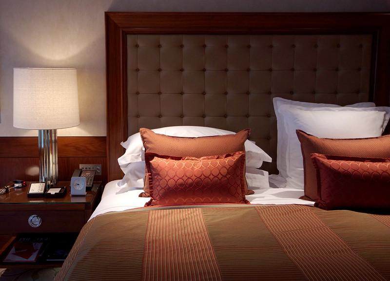 bedside table in the harbour room - mandarin oriental hong kong