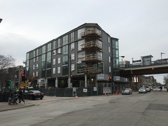 A TOD building is under construction next to the Paulina Brown Line station.