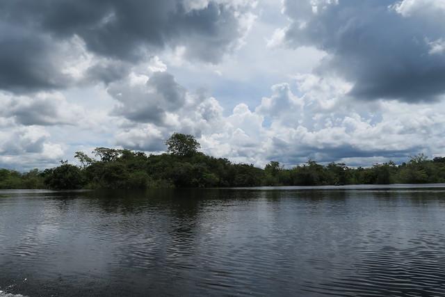 river bank dark cloud amazon tupana river