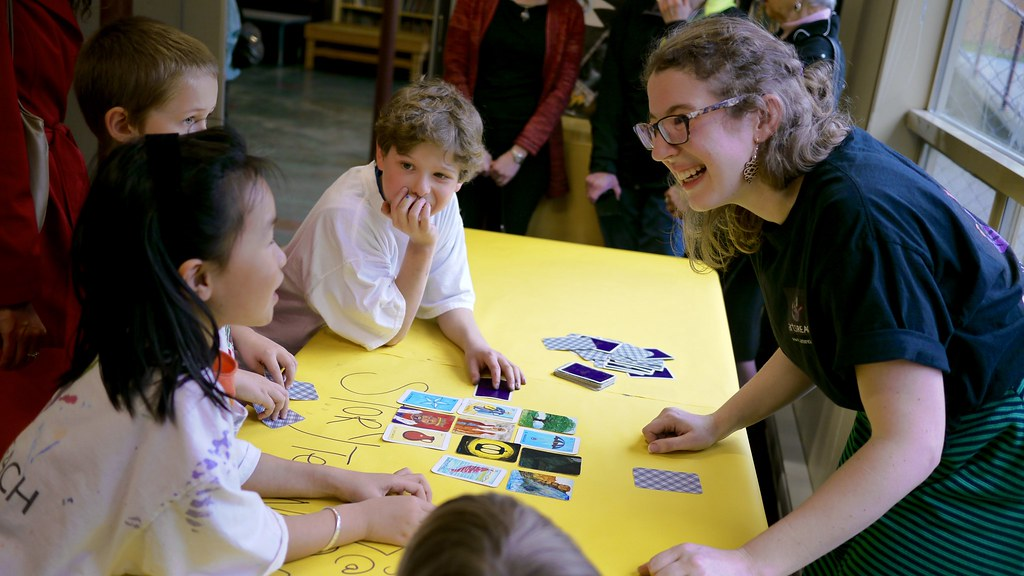Theatre instructor Erica Petty leads a storytelling workshop to children at the artsREACH 10th anniversary celebration.