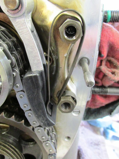 Cam Chain Tensioner Spring Installed in Groove of Tensioner Arm