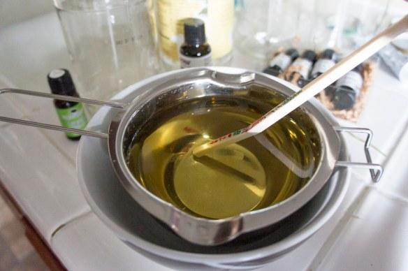Stir Essential Oil into Wax DIY Candles