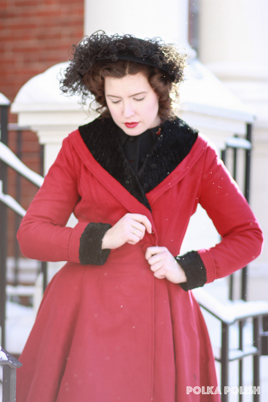 Hell Bunny Vivien coat in red styled with a vintage 1950s hat for winter