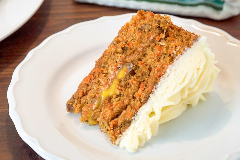 slice of carrot cake with orange curd and cream cheese frosting