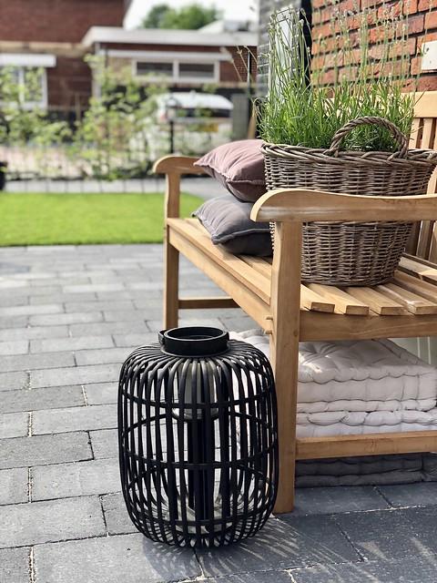 Houten tuinbank matraskussen windlicht