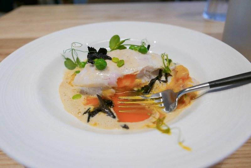 Halibut Stuffed with Egg Yolk, peas, black trumpet mushrooms, sauce mignonette | Hans Haas, Tantris, Munich, Germany, 2010 ($36)