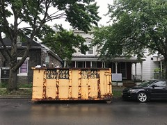 Construction dumpster in front of duplex house, 3119 Barclay Street, Baltimore, MD 21218