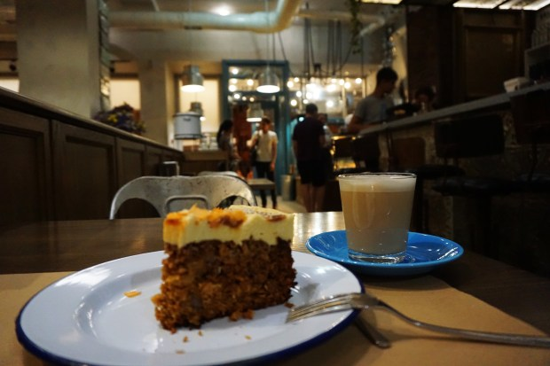 Enjoying a carrot cake and a latte at the Milk Bar