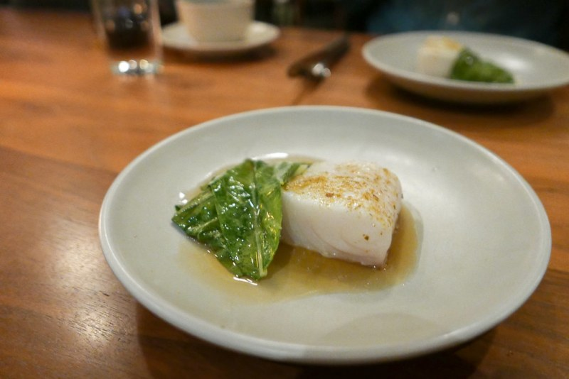 Poached halibut with bok choy, glazed mussels, preserved lemon, and chamomile