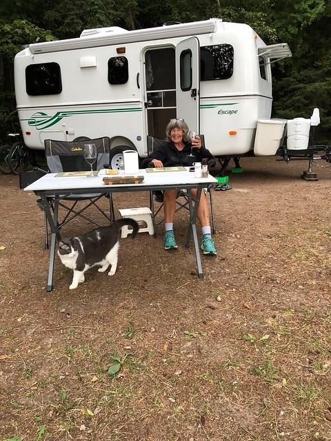 Pancake Bay campsite dinner facing camp with cat