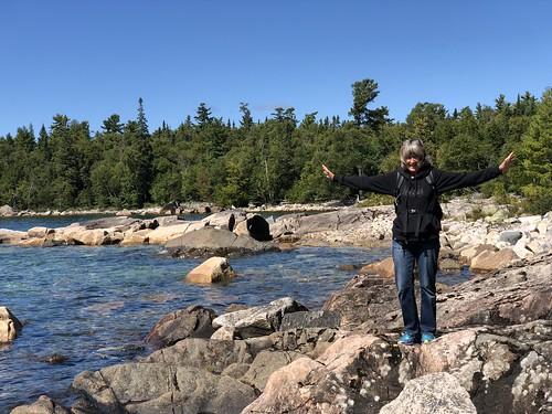 Lake Superior Park Linda balancing on rocks