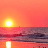 a lurid colour sunset over the sea
