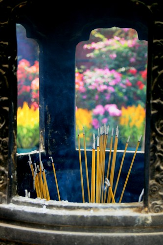 Incense with flowers behind