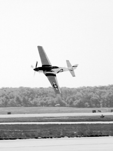 A P-51 fighter makes it's final pass before landing. No editing except for processing to black and white.