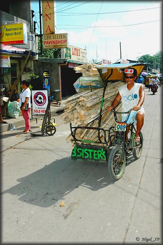 Cagayan de Oro, Mindanao tricycle pedal power timber transport Pinoy Filipino Pilipino Buhay  people pictures photos life Philippinen  菲律宾  菲律賓  필리핀(공화�) Philippines