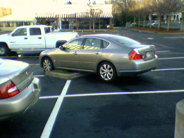 car taking four spots AND a curb island