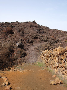 The path disappears beneath a lava field