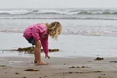 Kid plays in water and sand  on Morro Strand S...