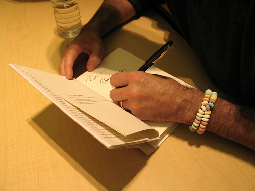 Writer's Hands III, hands of Candyfreak author, Steve Almond, signing a copy of his latest book, (Not That You Asked) Rants, Exploits, and Obsessions, Minneapolis Central Library, downtown Minneapolis, Minnesota, October 2007, photo © 2007 by QuoinMonkey. All rights reserved.