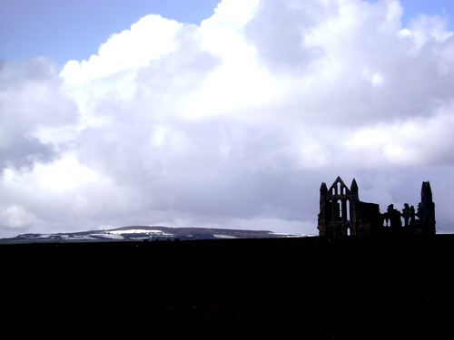 Whitby Abbey with the snow over the moors