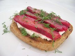 Salmon cured with beetroot and vodka, with cream cheese on malted toast