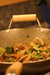 stir-frying pork and broccoli