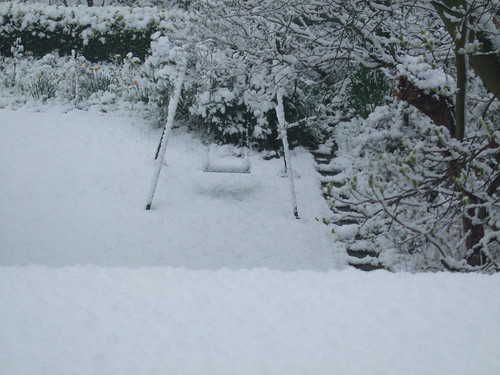 Snowy garden with swing