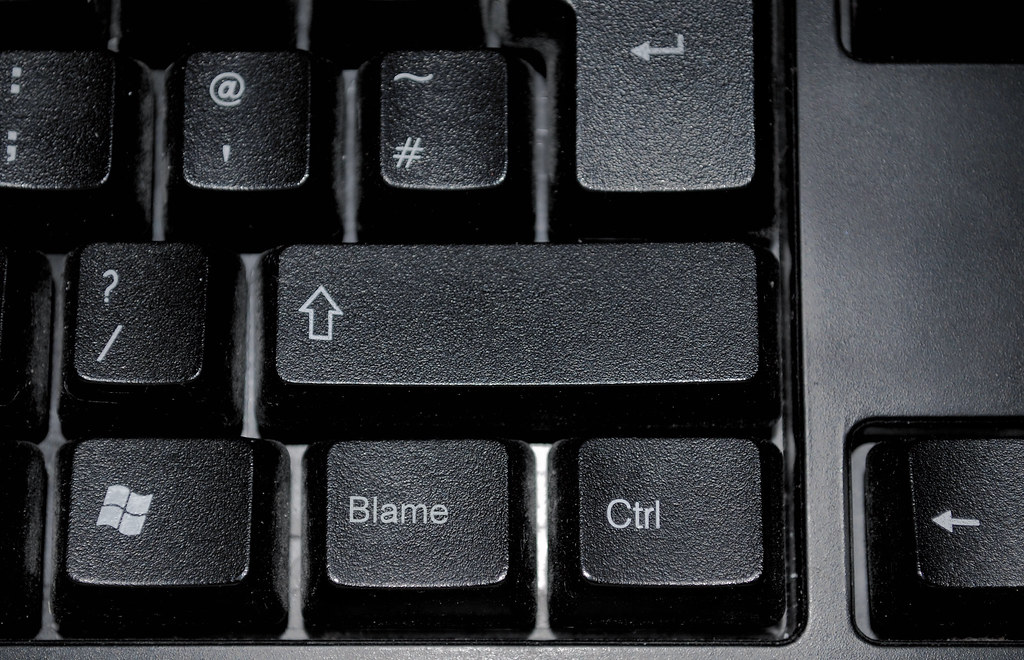 Keyboard with a special blame key