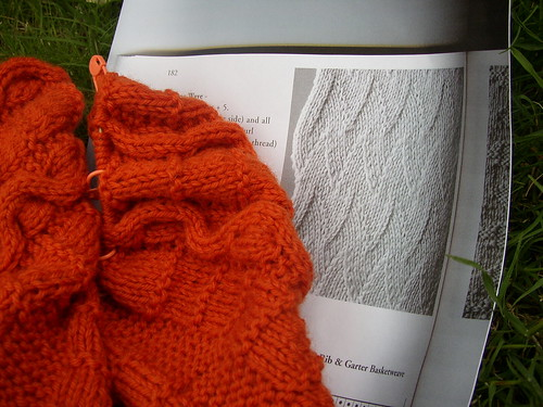 orange sweater and flame stitch