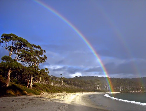 Rainbow on beach.