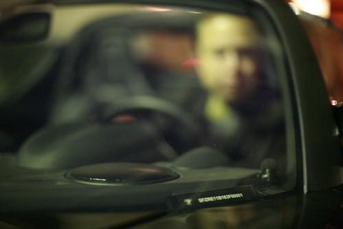 Elon Musk, Tesla Chairman, through windshield of first production Tesla