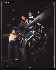 Women at work on C-47 Douglas cargo transport,...