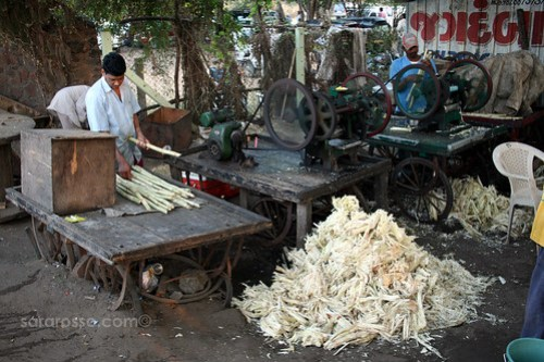 Crushing Sugar Cane into Juice, Dandi Beach India