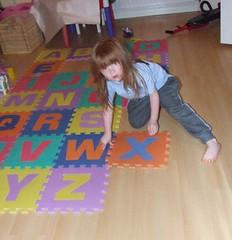 Aine installing her new Alphabet Mat